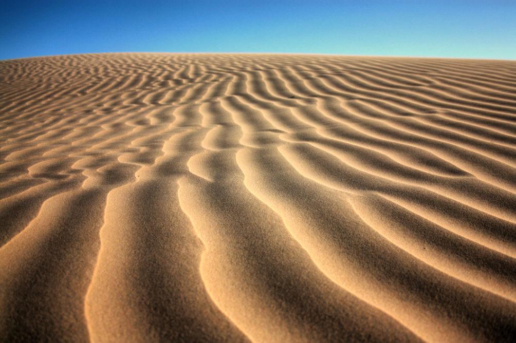 تفسير حلم الغوص في الرمل في المنام